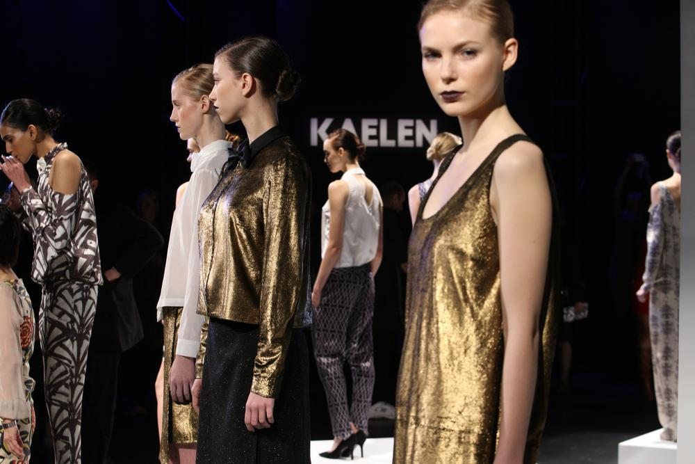 Models stand on runway for KAELEN show in 2012