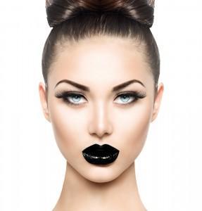 Model wears black lipstick