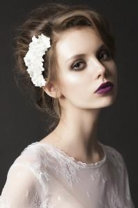 Model wears purple lipstick