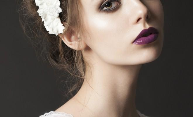 Model wears purple lipstick