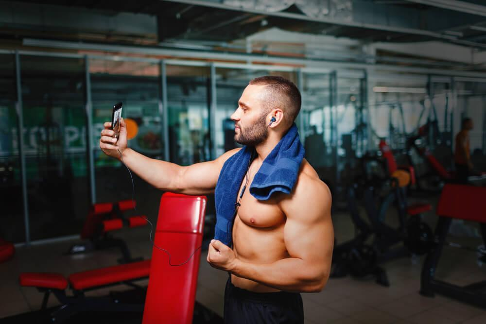 man taking selfie in gym
