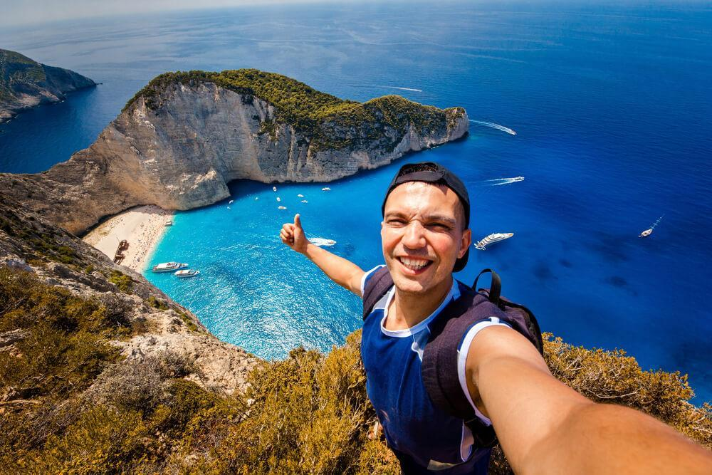 man taking selfie while traveling