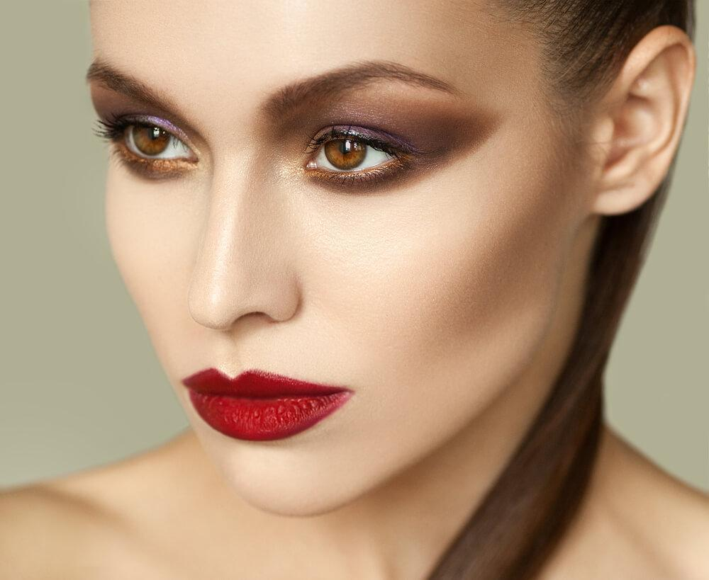 woman with smoky eyeshadow and deep red lipstick
