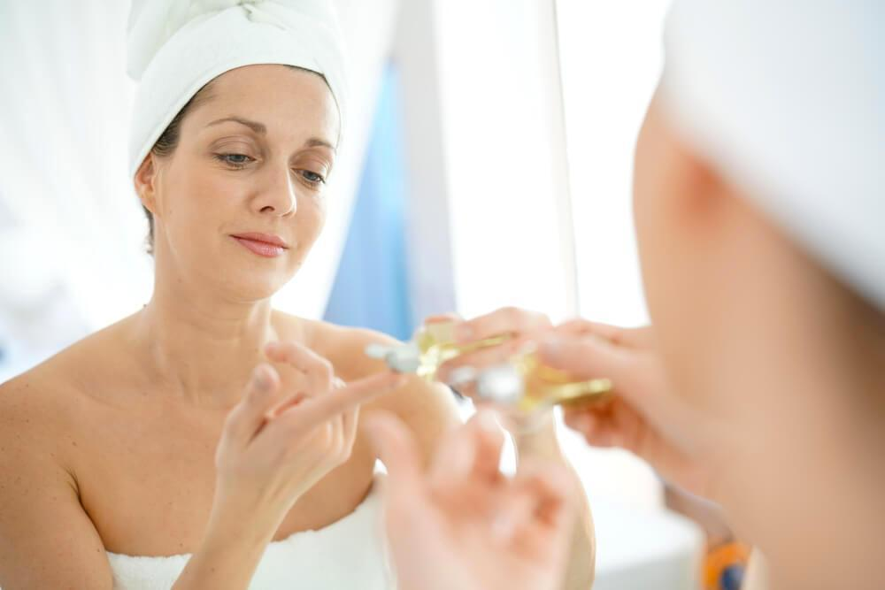 Woman applying serum to skin