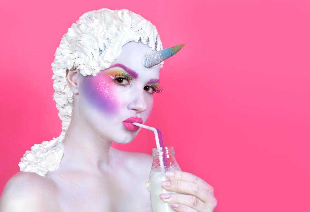 Woman with ethereal unicorn makeup and white hair