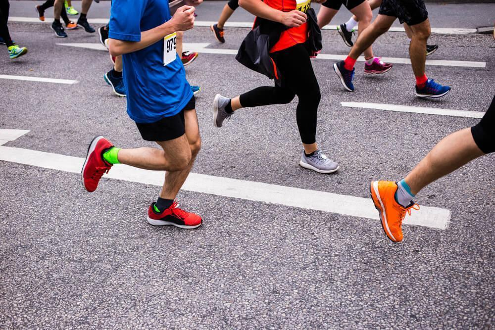 Unknown group of people in running shoes