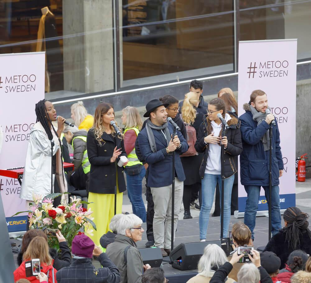 STOCKHOLM, SWEDEN - OCT 22, 2017: Artists from Swedish Idol competition supporting the #metoo campaign against sexual harassment at Sergels torg in Stockholm. October 22, 2017, Sweden
