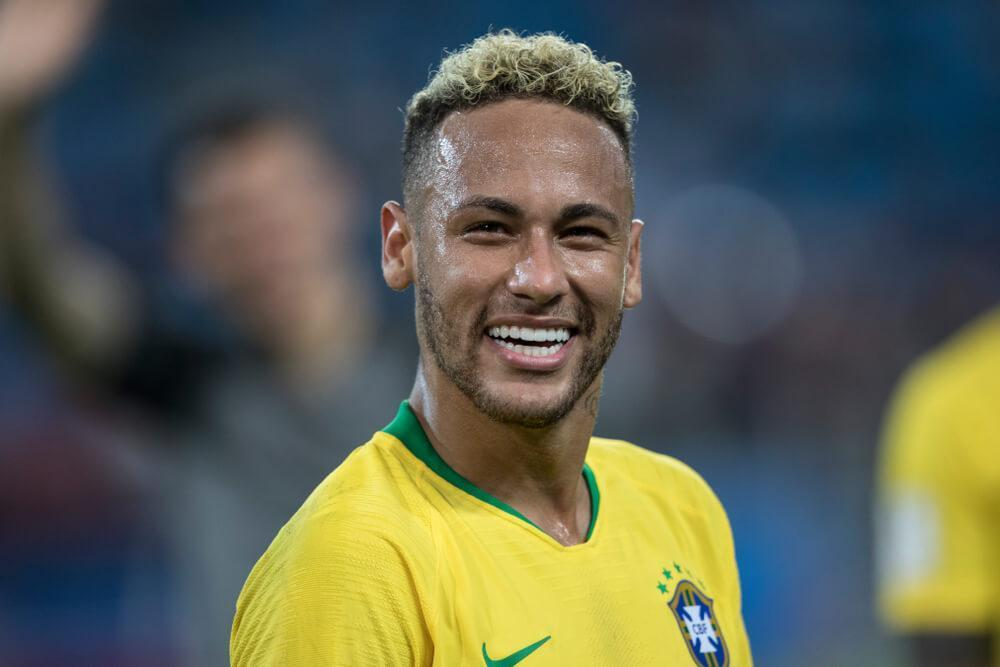 Neymar on the football pitch smiling