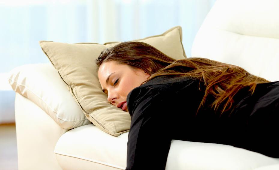 exhausted woman sleeping on the couch
