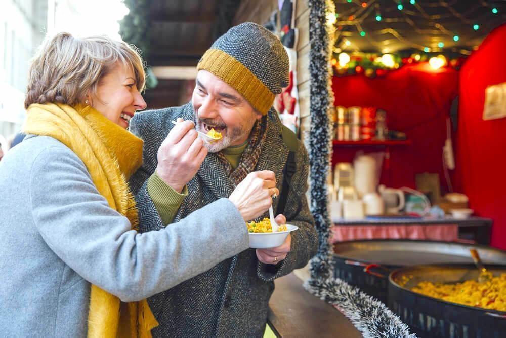 senior couple at Christmas market