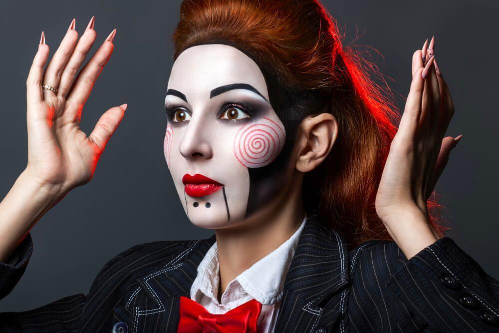 Woman with red hair and funky jigsaw themed makeup