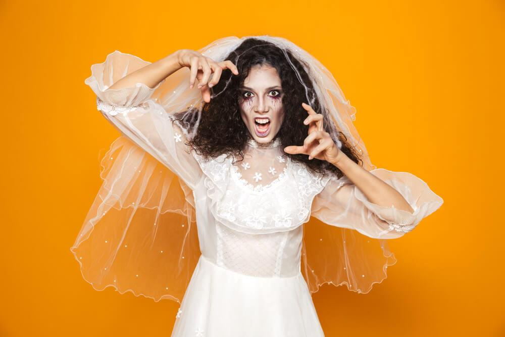 Scary bridge with long veil and white gown