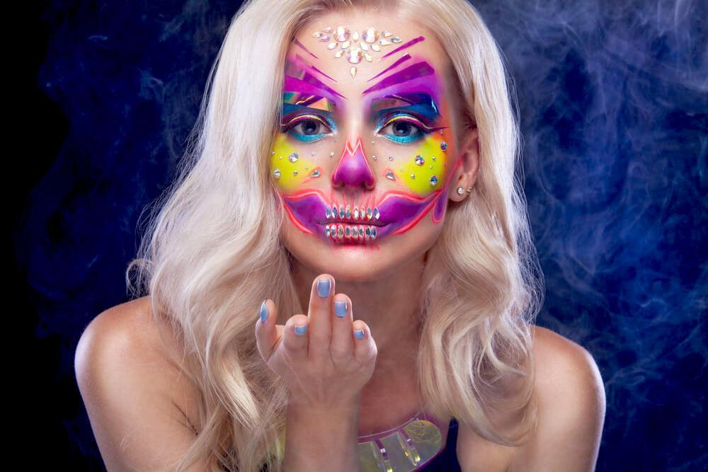 Woman with neon skull makeup