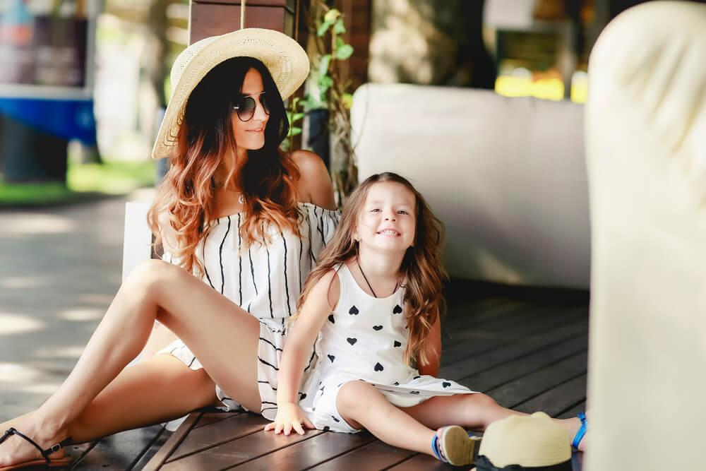 Happy fashionable woman with young daughter