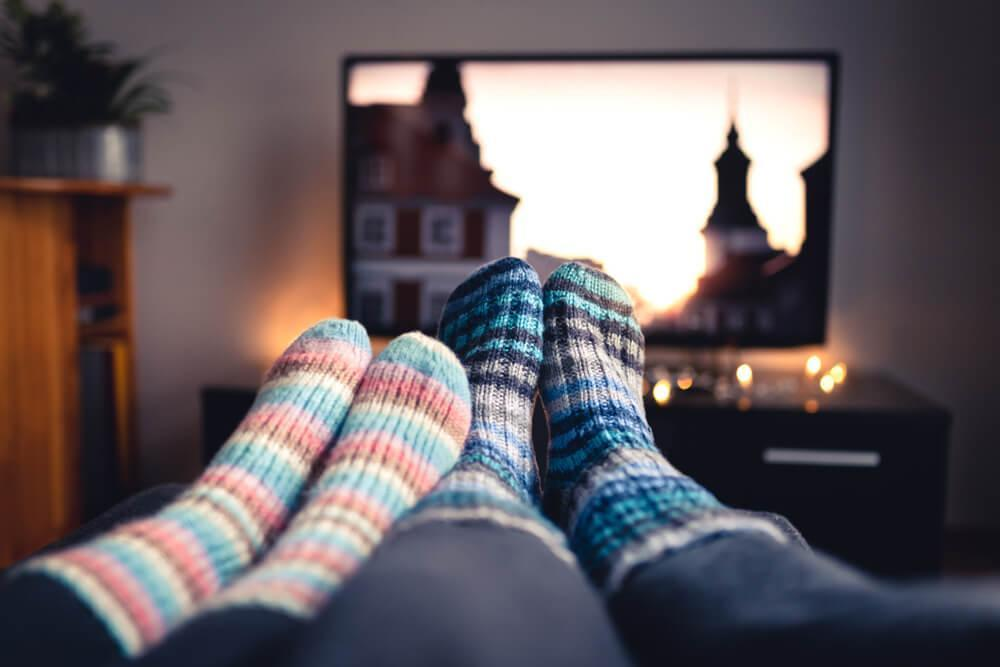 Couple wearing socks watching TV