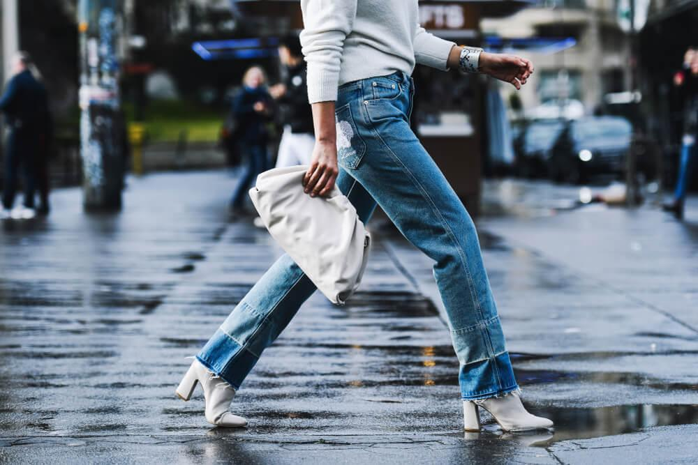 Woman walking on street wearing jeans