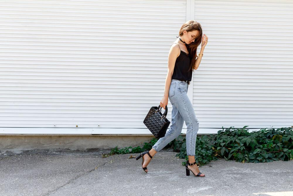 Woman walking wearing jeans and high heels