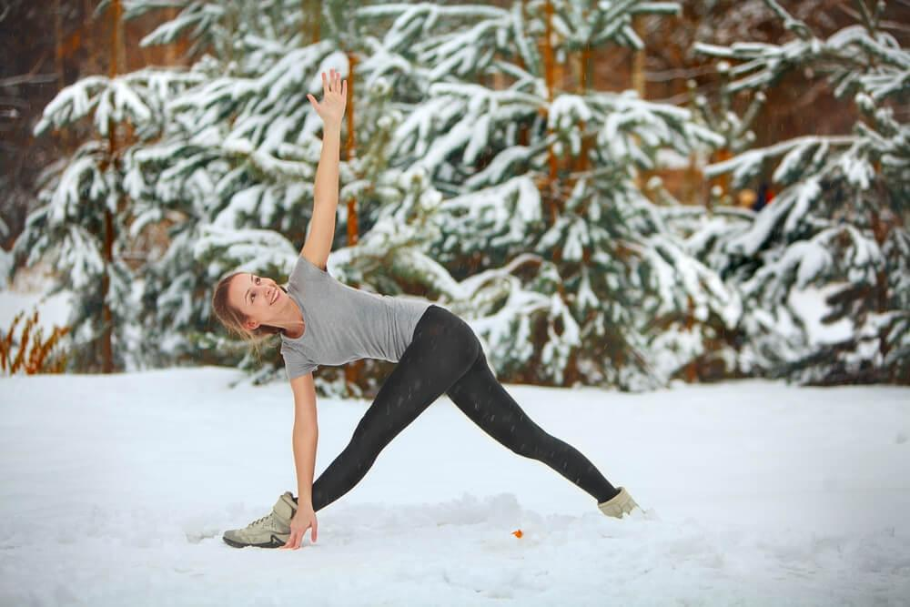 Woman exercising in snow