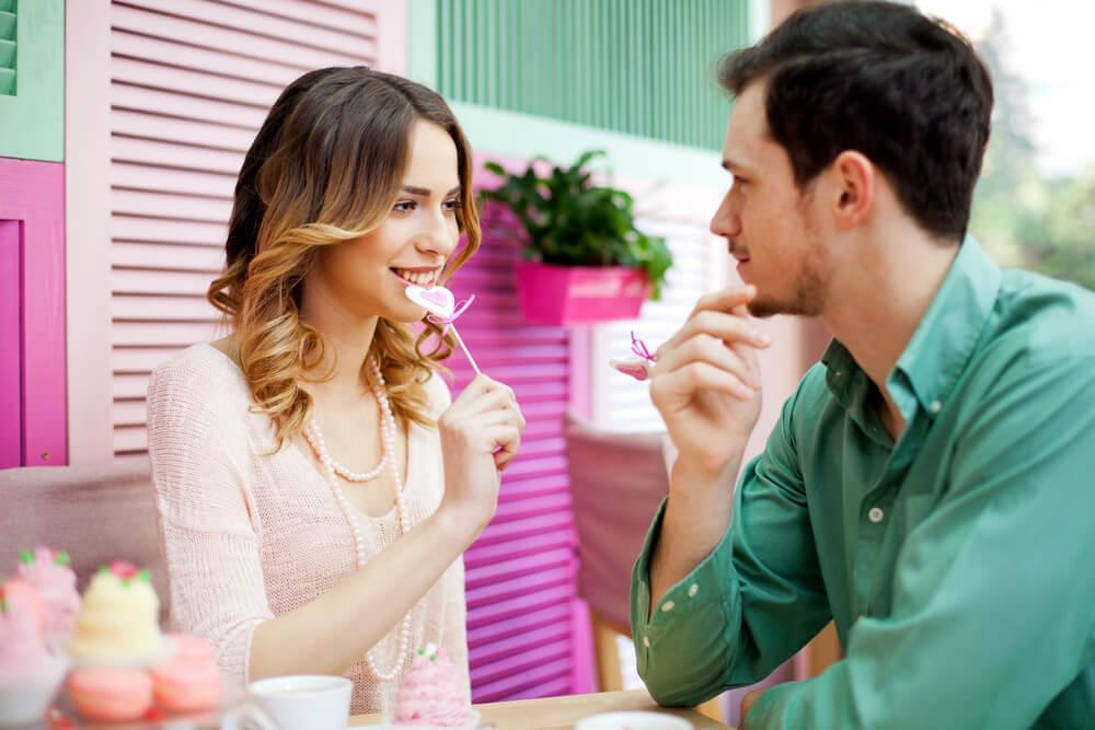 Couple looking at each other at cafe