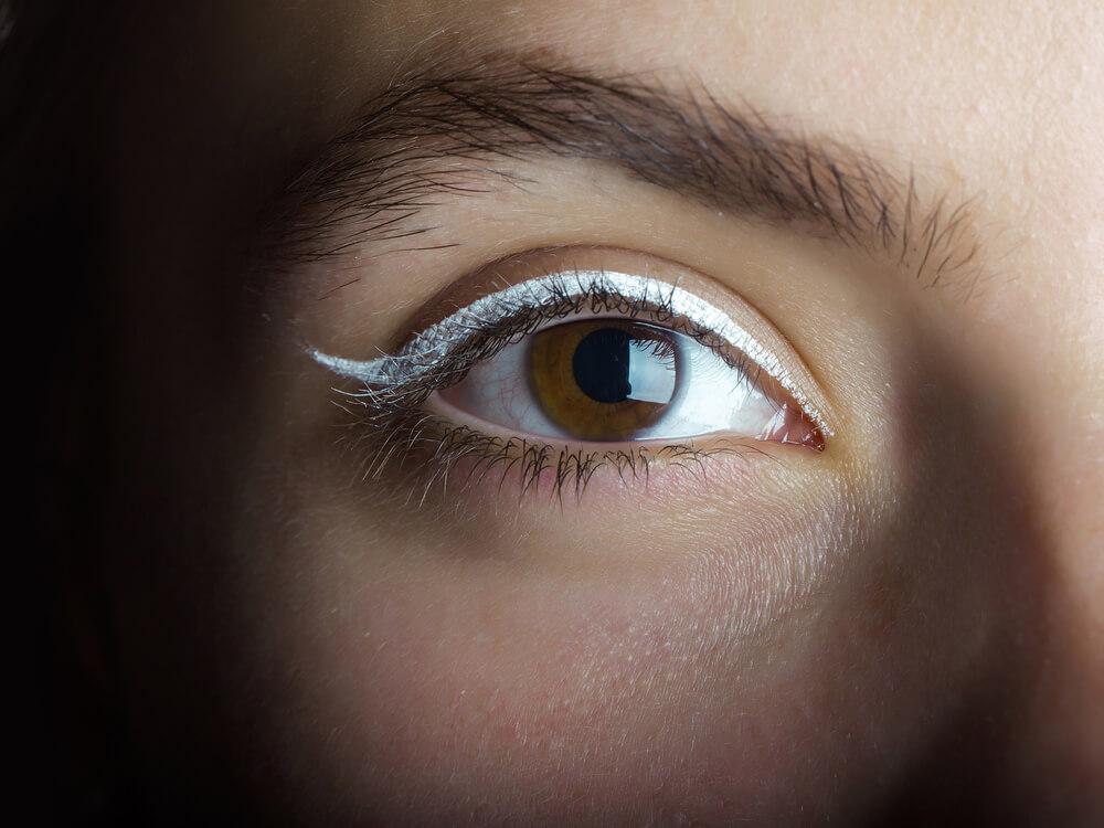 Eye with white eyeliner