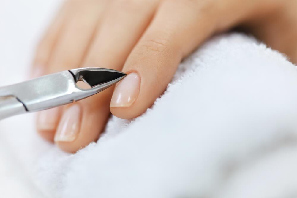 Cuticle care tool on nail