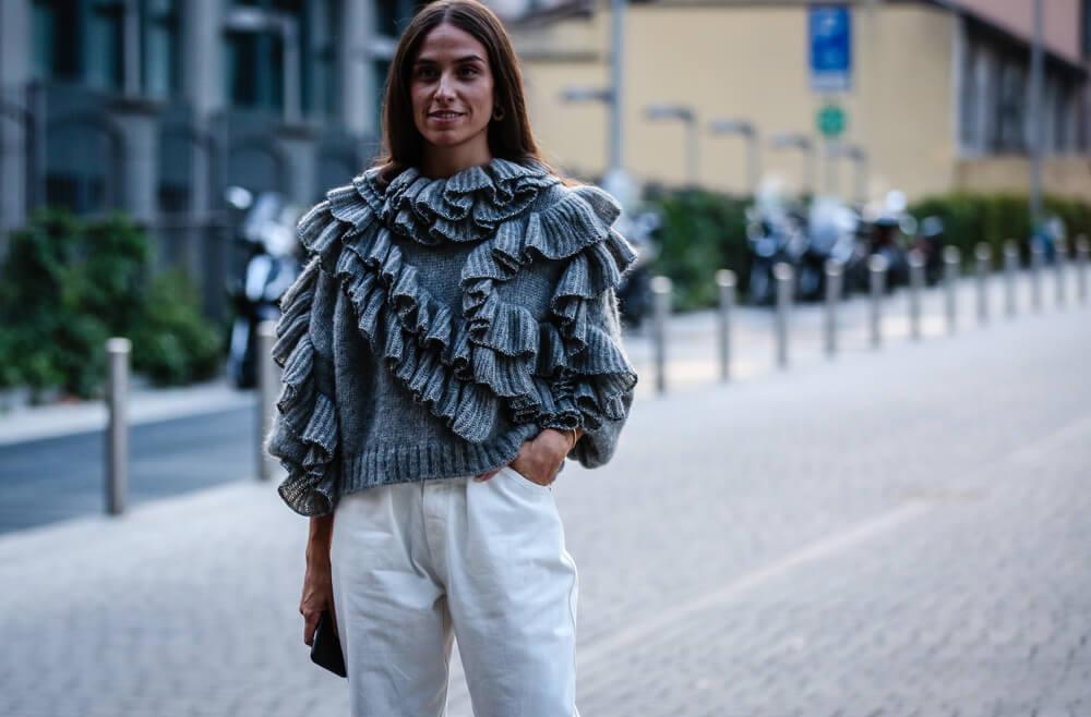 Woman wearing ruffled top