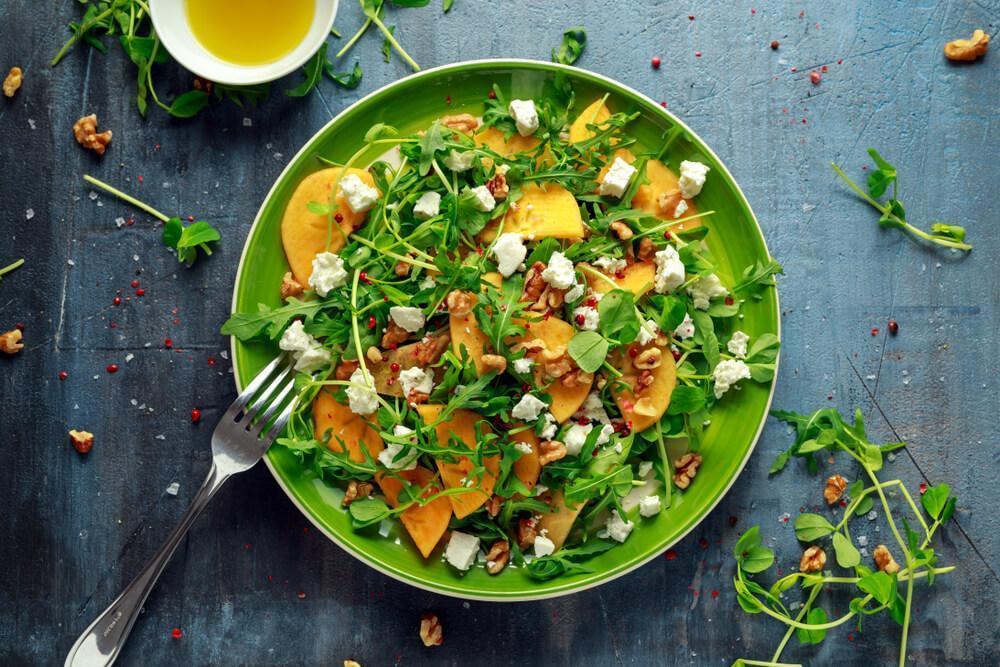 Persimmon salad on plate
