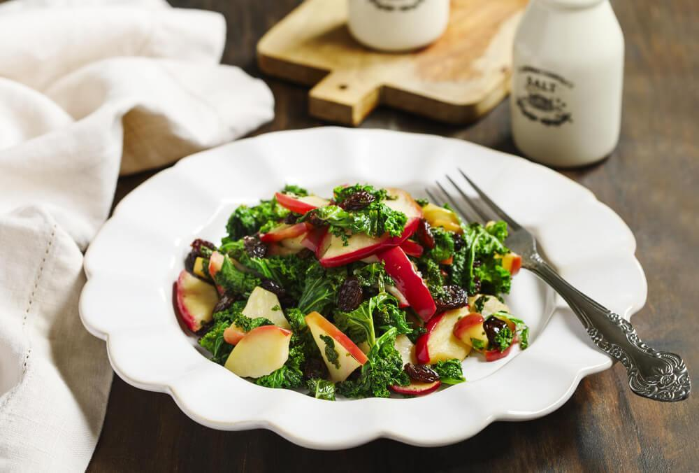 Apple kale salad in bowl