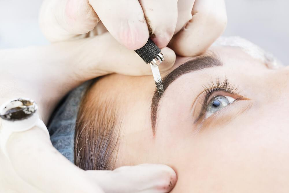 Woman having microblading treatment