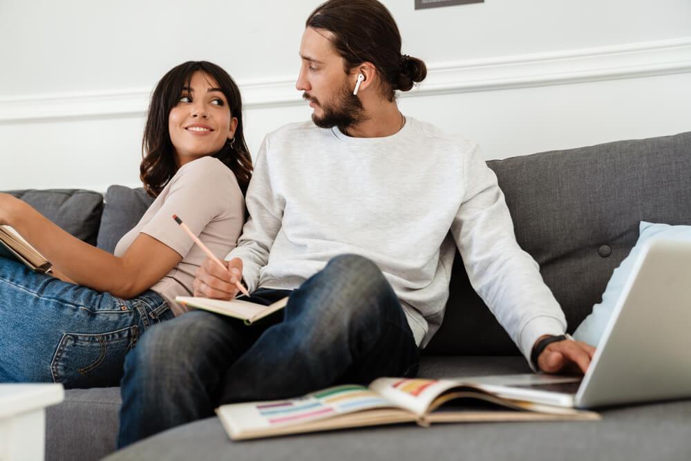 Couple on sofa working